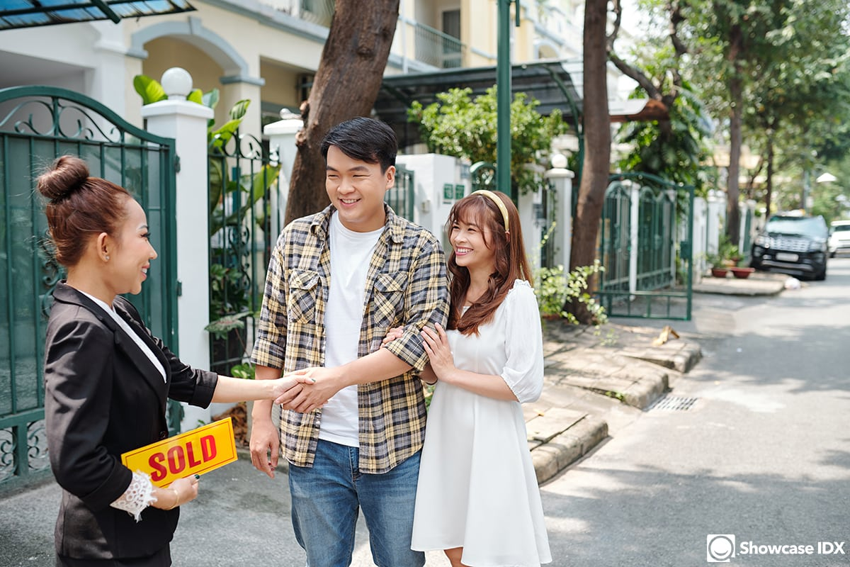 real estate agent and couple buying first home