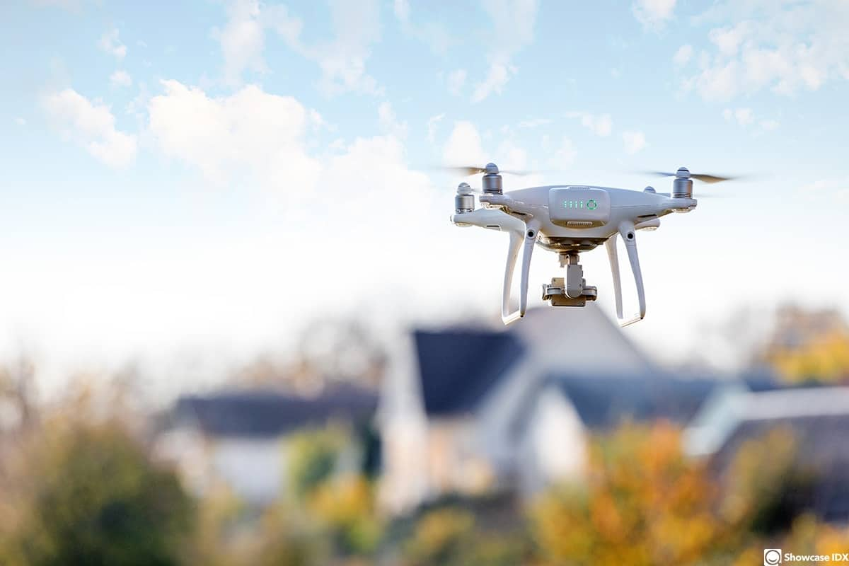 real estate marketing materials drone flying front of home